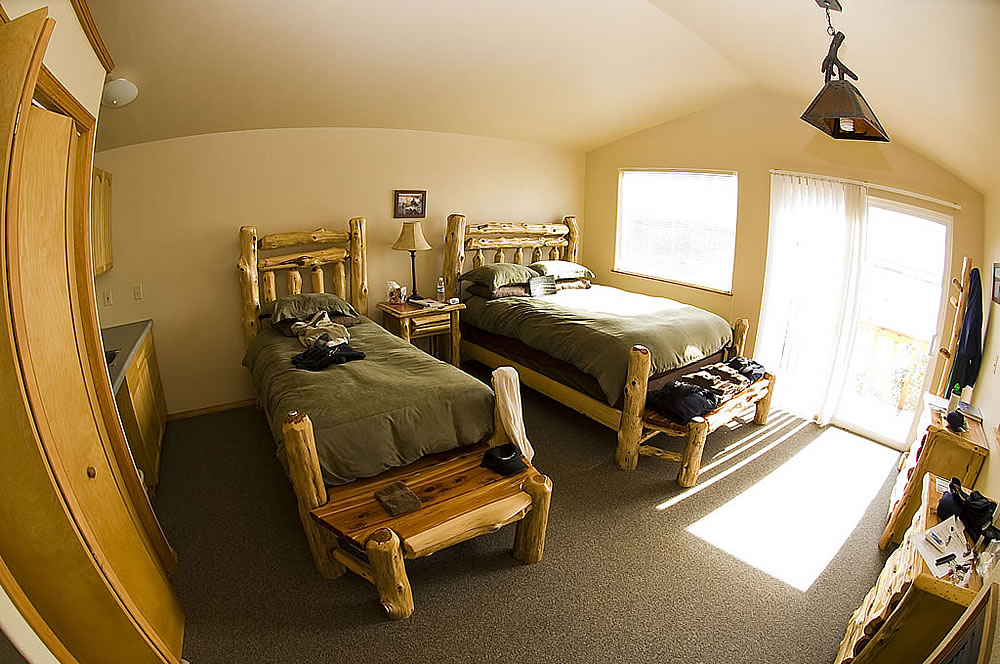 Guest cabin with two twin beds at the Bear Trail Lodge
