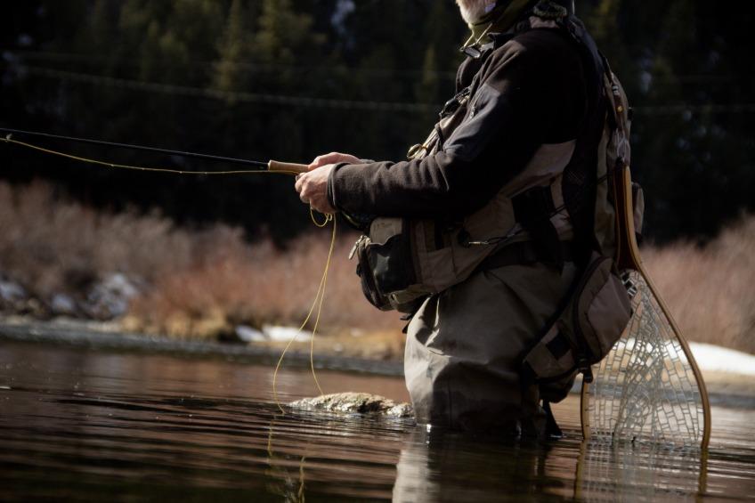 man fly fishing